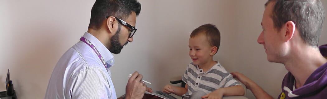 CHECT photo - doctor examining child's eye