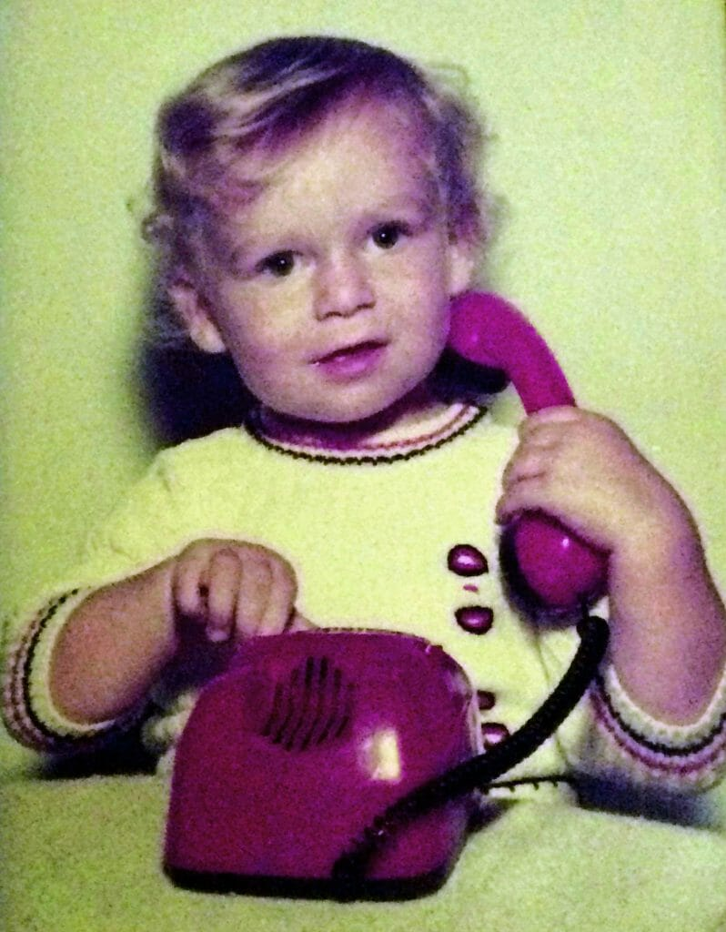 CHECT photo - Matt Holt as a small child, playing with a red phone
