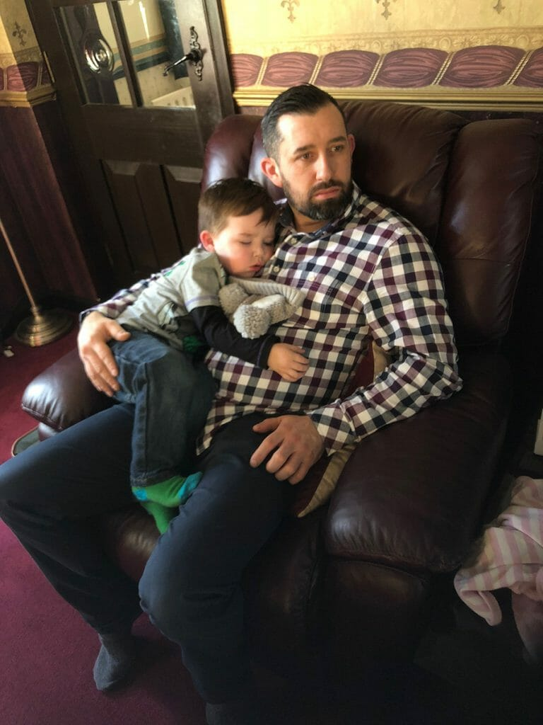 CHECT photo - Gavin Brown and his son Logan, sitting on the sofa cuddling