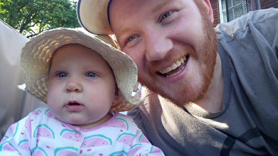 CHECT photo - Jerome Lawler with his daughter Indiana, they are both wearing sunhats, looking at the camera and smiling