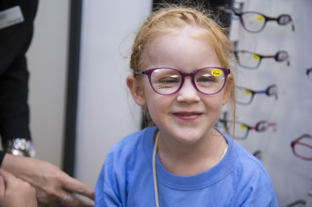 CHECT photo - young member attending a Vision Express store event