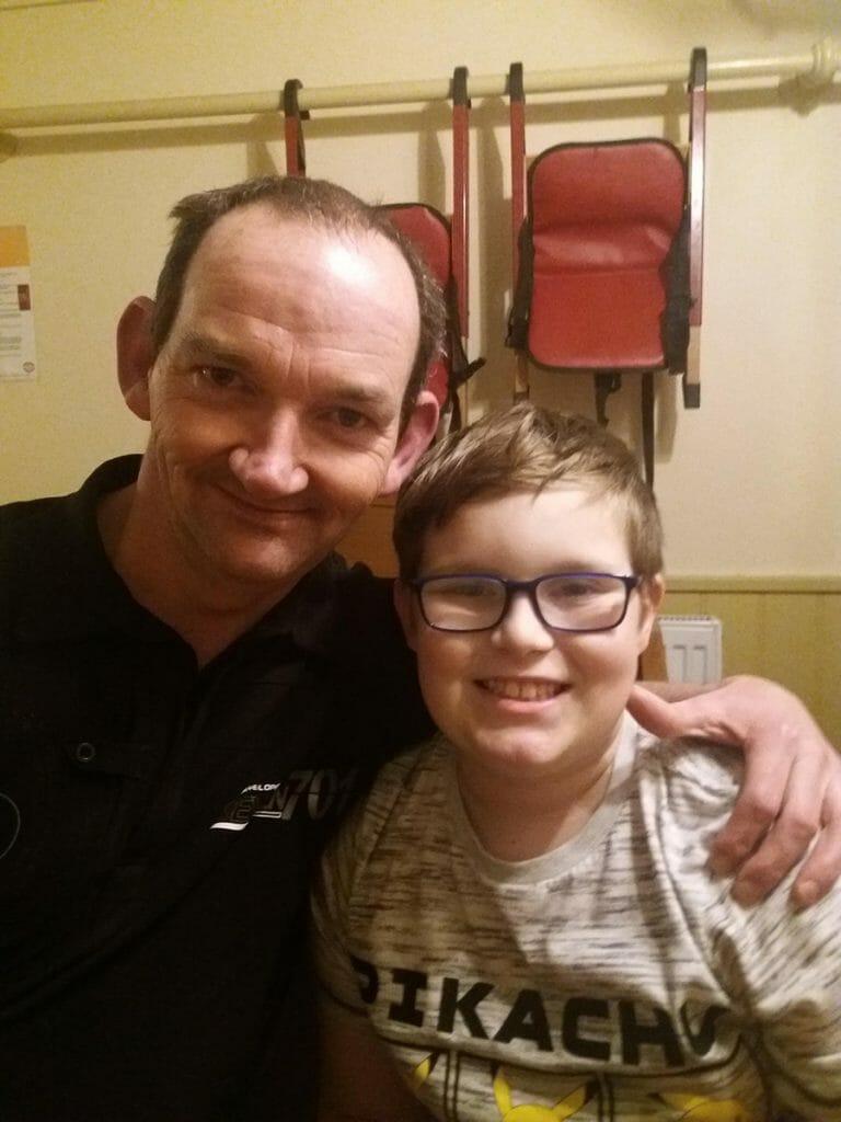 CHECT photo - Thomas Lawson with his dad Robin, both smiling at the camera