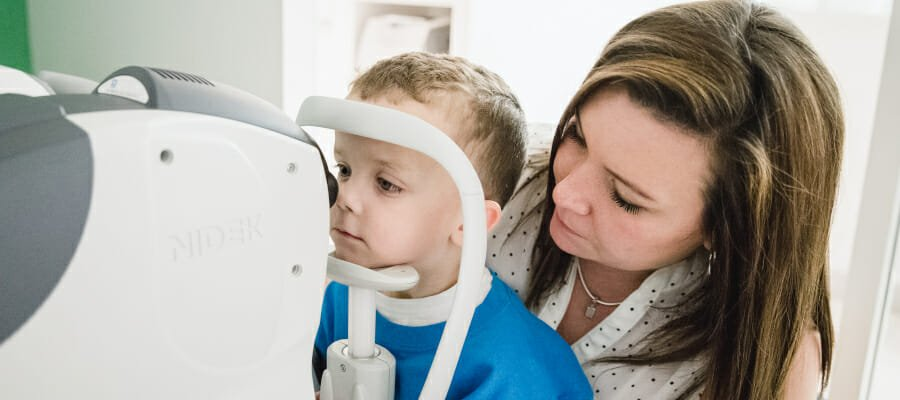 Photo of a little boy having his eyes tested