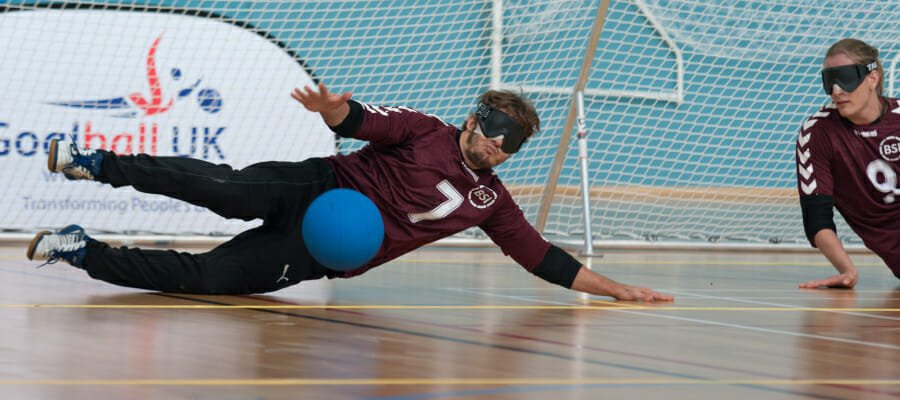 Photo of two people playing goalball