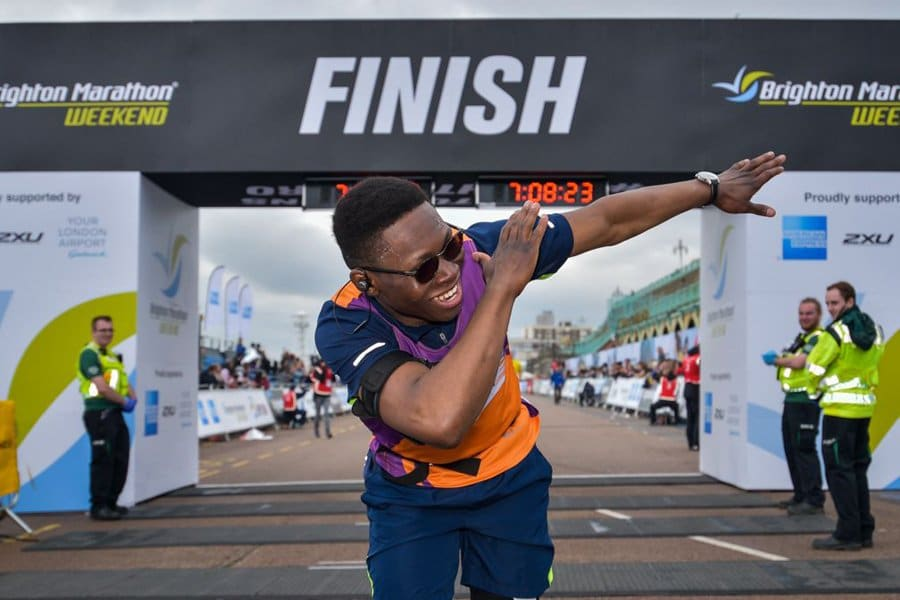 a super happy guy crossing the brighton marathon finish line and dabbing at the same time!
