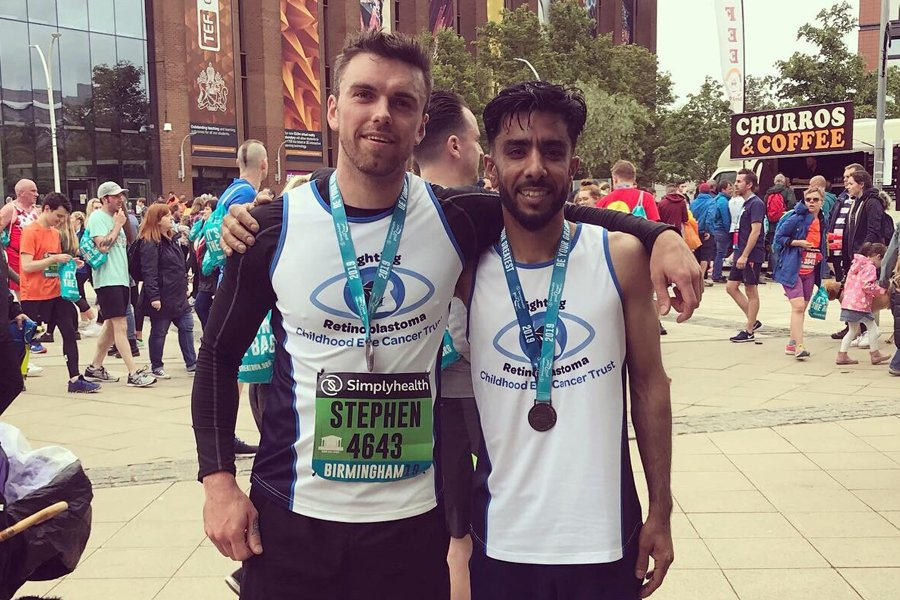 Two men with their medals after the Birmingham 10k run