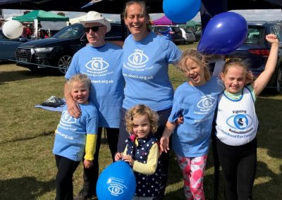 A family with CHECT t-shirts and balloons