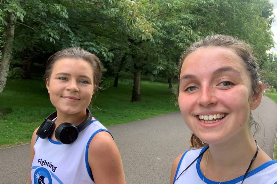 Two young friends taking a selfie on their walk for CHECT