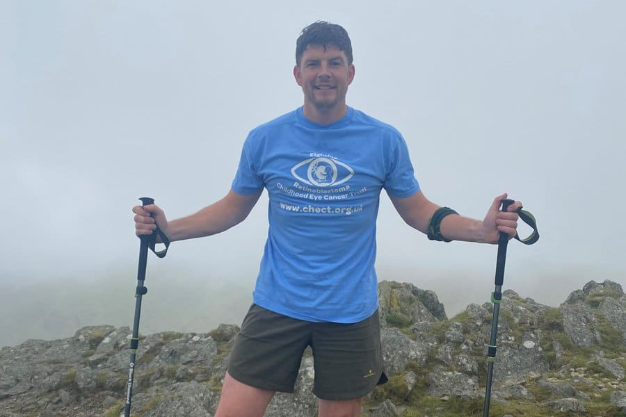 Karl with his walking sticks up in the clouds on a very high peak