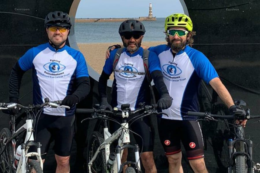 Three men posing with their bikes on a Whitehaven to Sunderland cycle