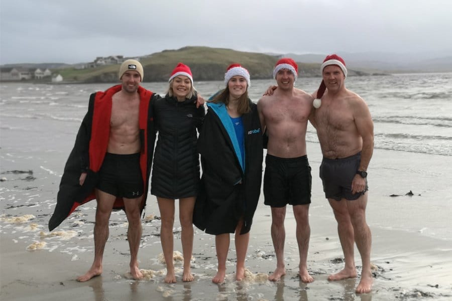 5 chilly looking people after their annual christmas day swim