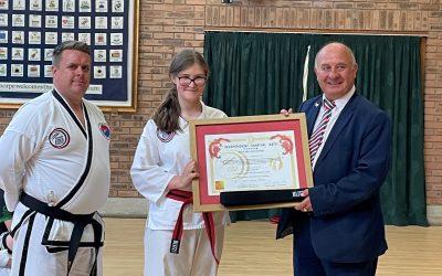 Olivia Earns A Black Belt in Taekwondo