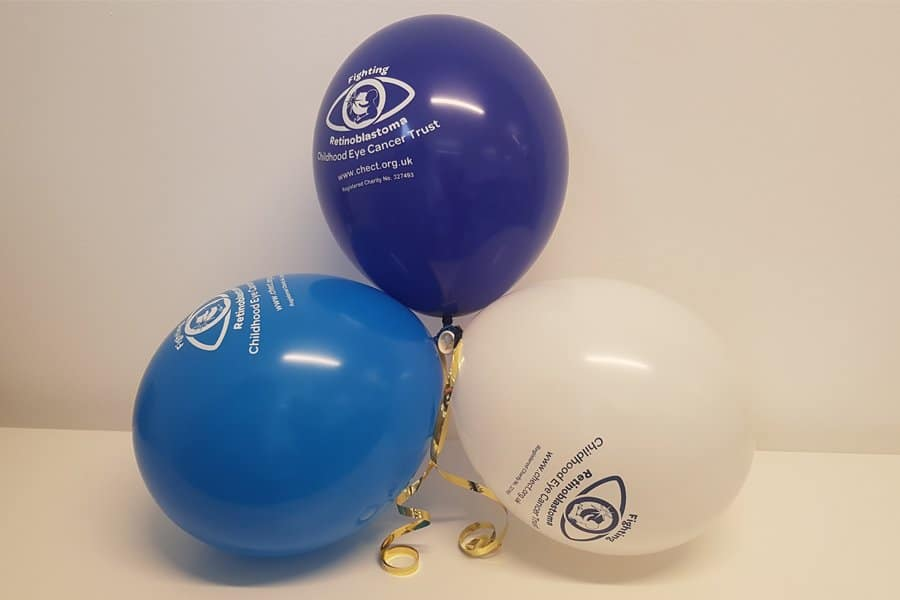3 inflated CHECT balloons - White, light blue and dark blue. Tied together with a gold ribbon.