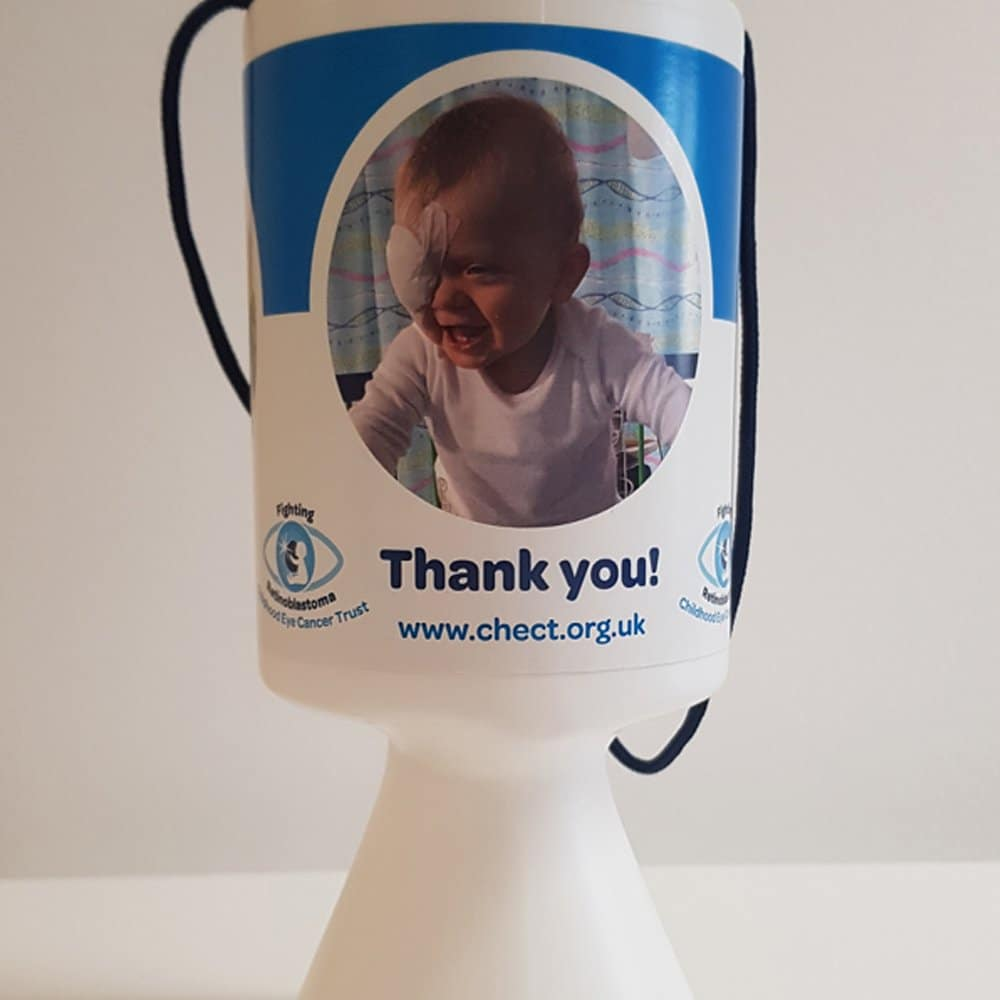 Collection tin. White with three pictures of CHECT members on and text reading Thank You as well as the CHECT website